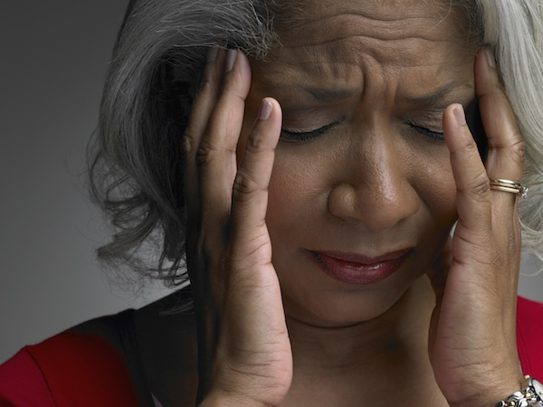 Woman experiencing an episode of dizziness