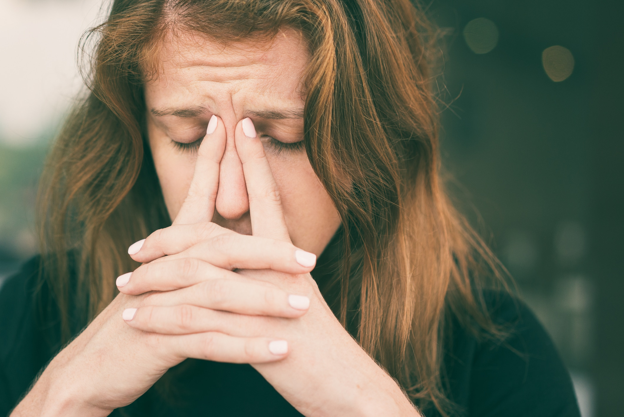 women massaging nose in pain